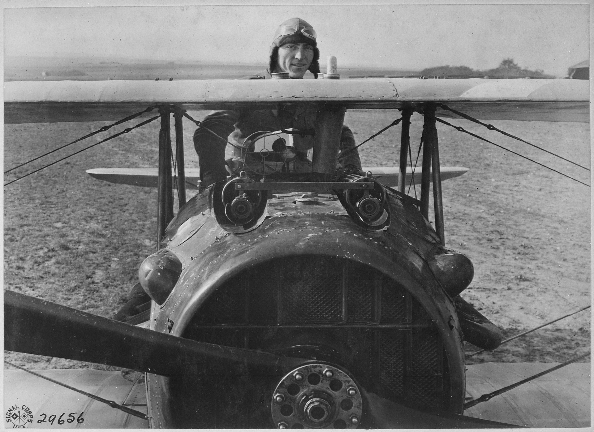 First_Lieutenant_E._V._(Eddie)_Rickenbacker,_94th_Aero_Squadron,_American_ace,_standing_up_in_his_Spad_plane._Near..._-_NARA_-_530773.tif
